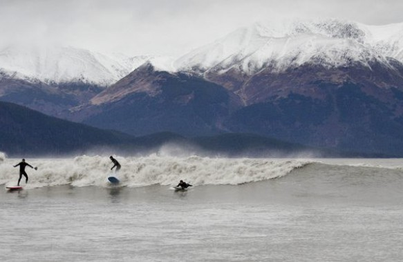 Alaskans surfing the Turnagain Arm bore tides.