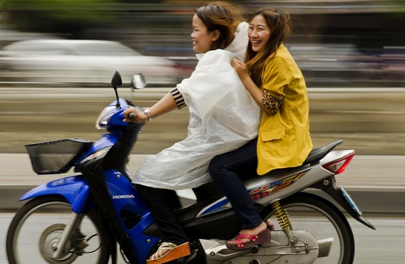 Girls riding motorcycle in Chiangmai Thailand