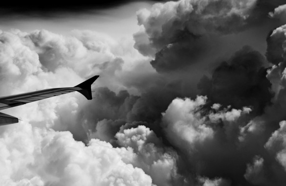 Storm clouds surround the jet over Chiangmai, Thailand.
